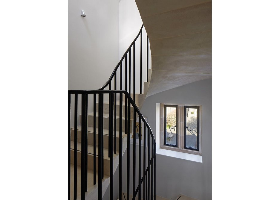 Solid stone stair is extended upwards in lighter cantilevered manner.