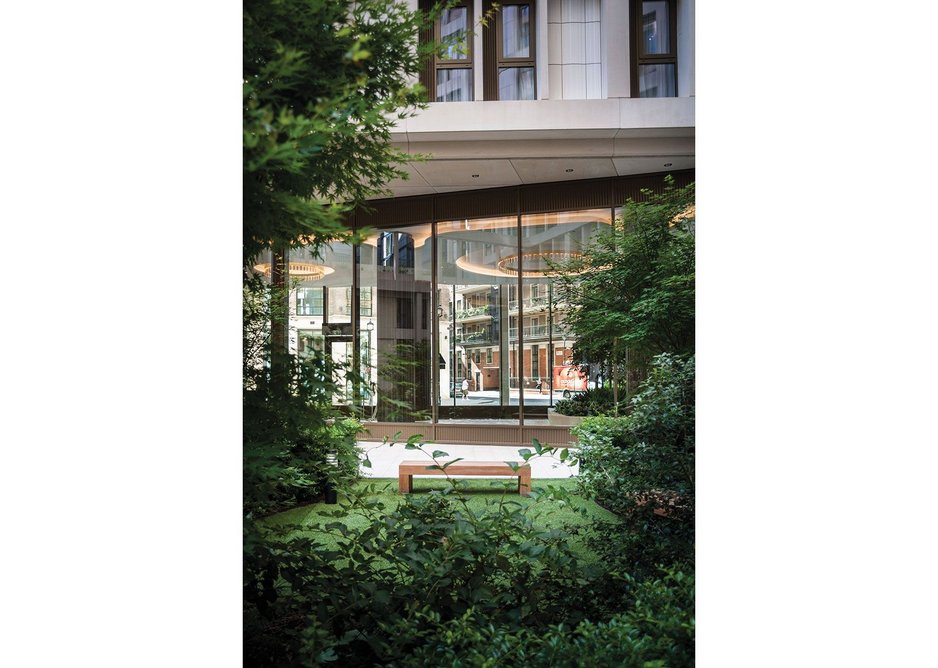 A glimpse of Project Orange's hotel-like lobby from the courtyard of Cleland House.