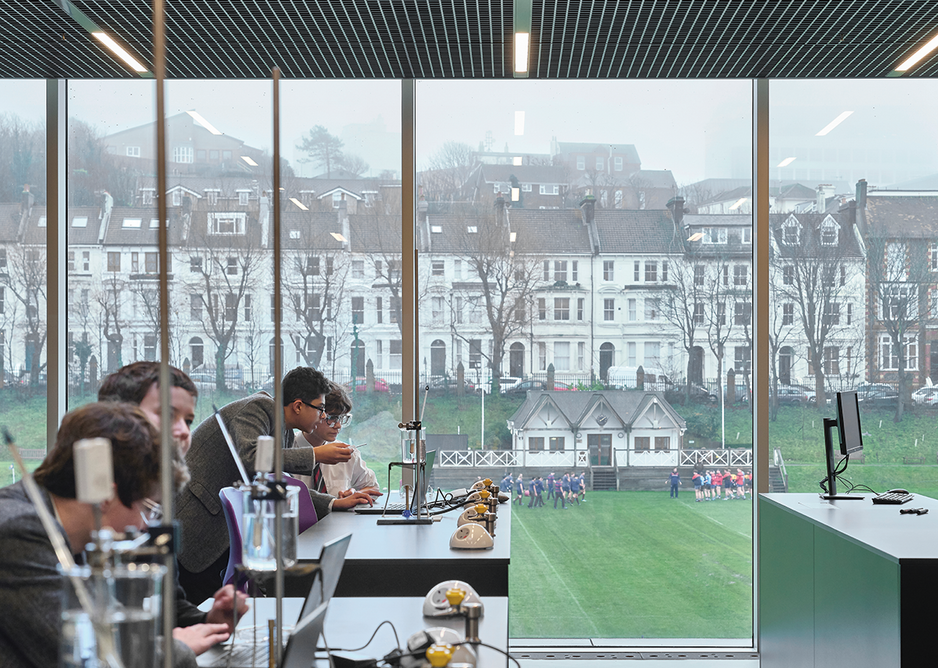 Views connect the science labs to the sports activities outside. The terraces that inspired the exterior can be seen in the distance.