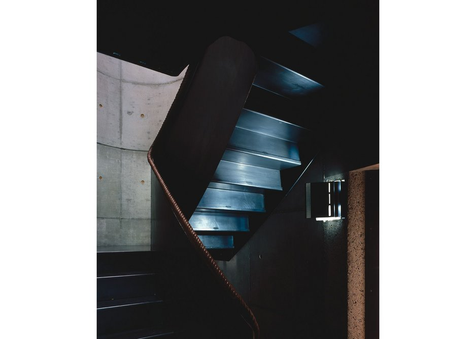 Elliptical staircases are the dark heart of the homes, drawing people up to the light.