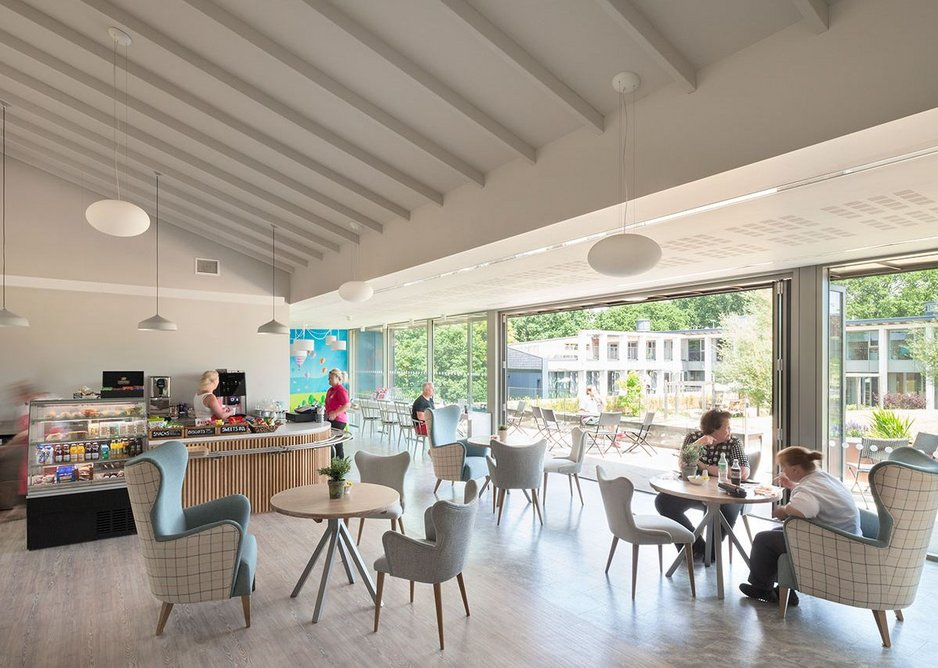Café with landscaped garden linking to the existing hospice. MacEwen Award 2019 shortlisted KKE's St David's Hospice Inpatient Unit, Newport, Wales.