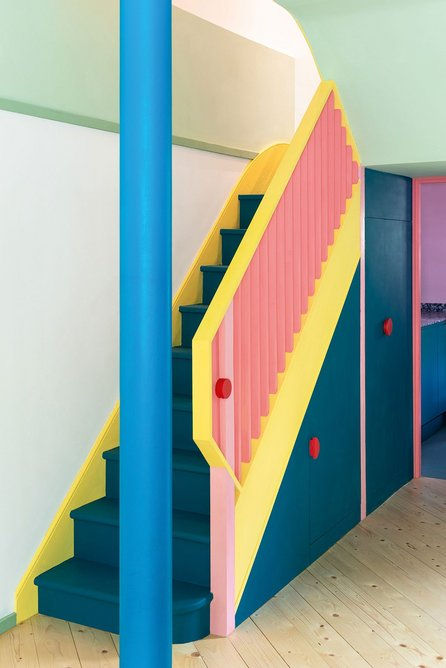 Candy store colours bring joy and life to this lower-level, gridded, family social space.