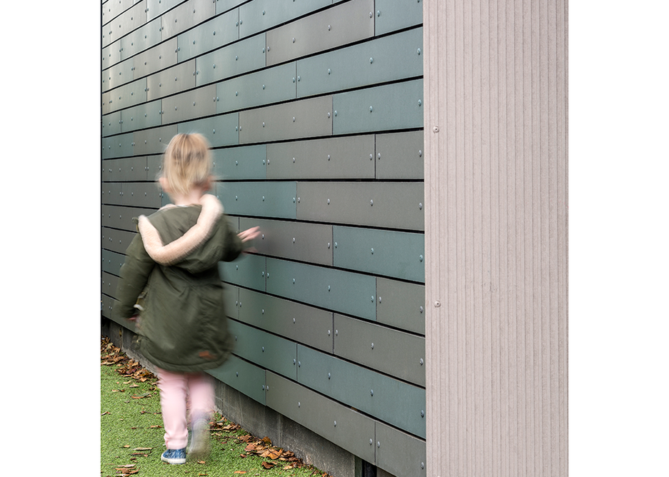 Texture at just the right height: A young girl runs her fingers across panels of Natura.