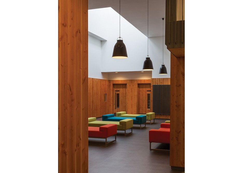 Douglas fir, floor tiles and lighting link the three social spaces visually even though they are spread across the building.