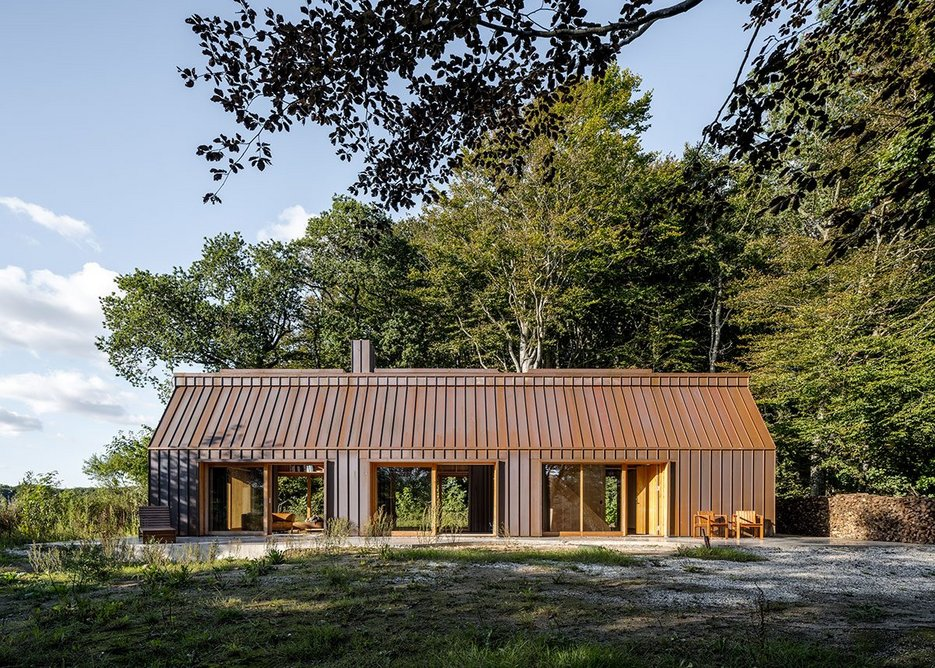 The copper standing seam cladding has already turned a rusty brown as it evolves towards green.