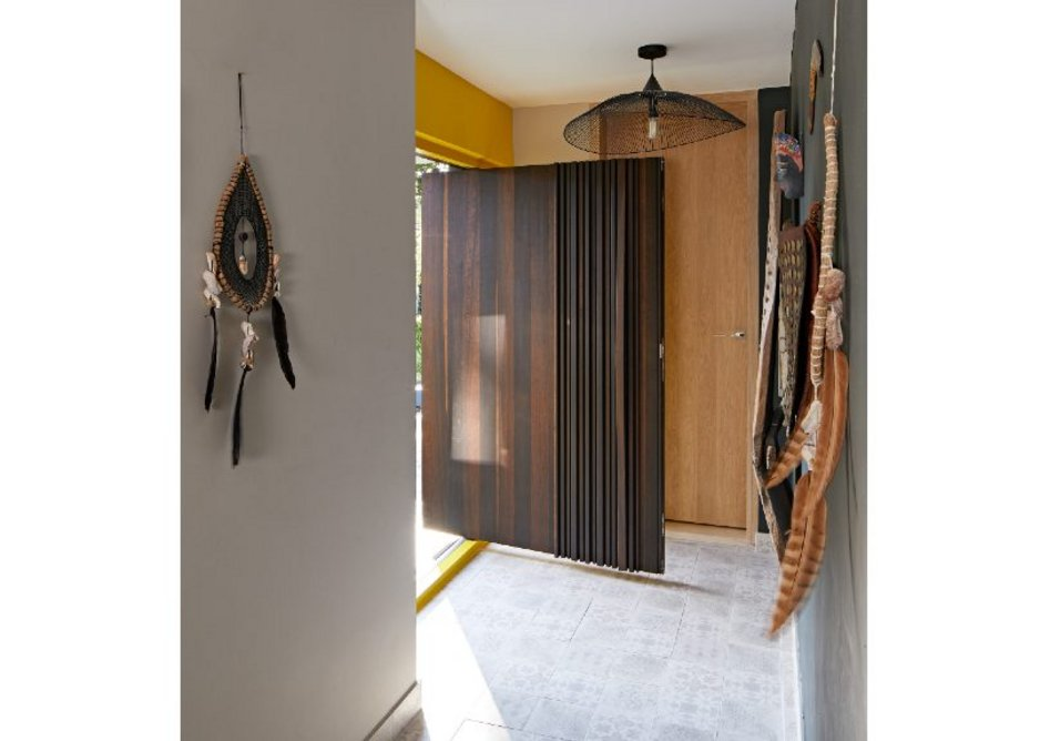 Urban Front Bari e80 pivot oversized doorset in Fumed Oak with concealed handle and matching sidelight.