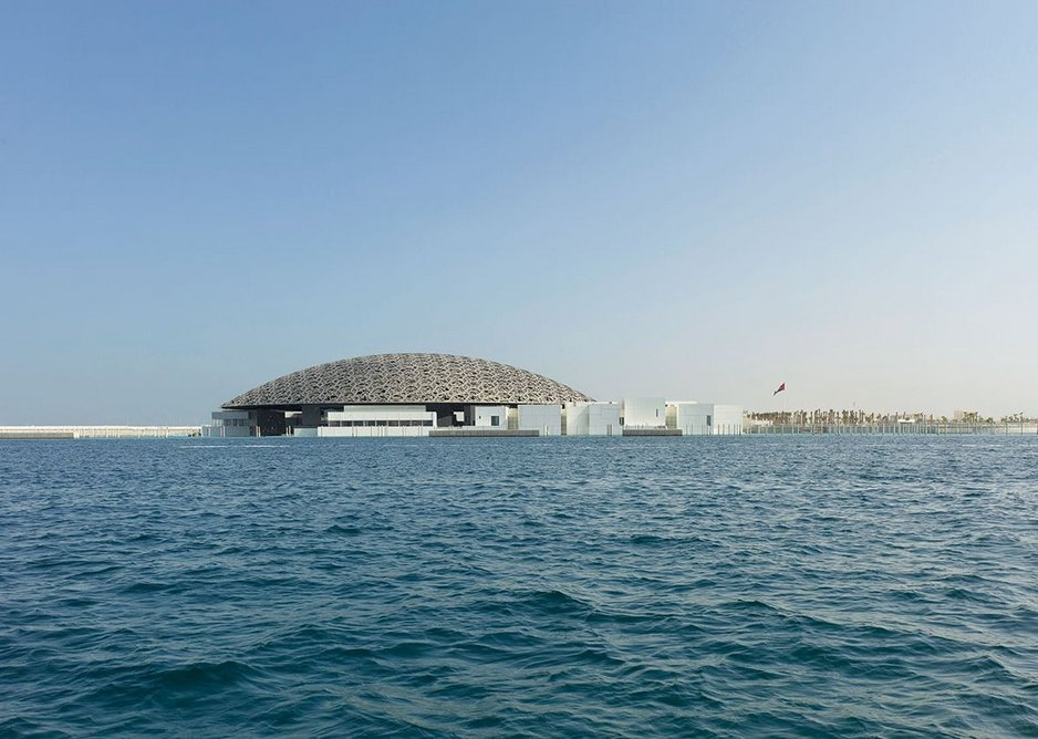 Louvre Abu Dhabi, like a Bond villain's lair, floating in the sea.