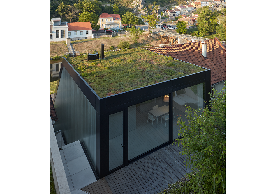The green roof extends over the building.