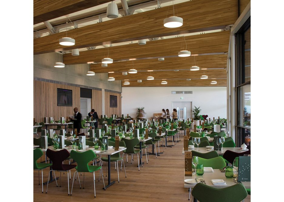 Inside the top floor restaurant at the Warner Stand. The acoustics had to work for pleasant member conversations on match days and throughout the year, come rain or shine, for event hire.