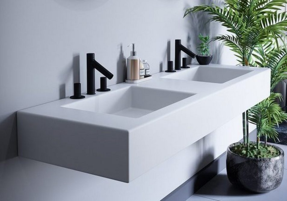 Durasein solid surface in Pure White can be used to create bespoke bathroom vanity units with a smooth seamless and hygienic finish.