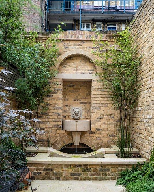Lutyens inspired fountain at rear of garden.