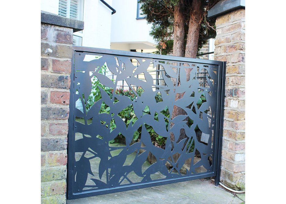 The ornate laser cut screens create an open pattern of light and shade without leaving the garden too exposed