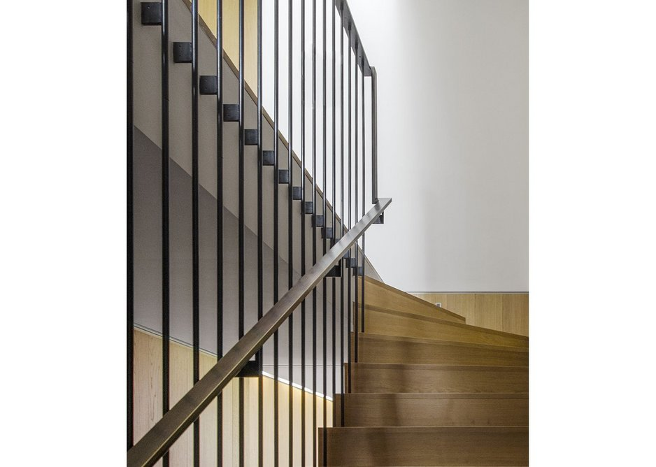 The main staircase with patinated mild steel handrail.