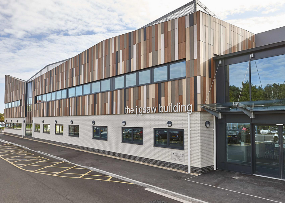 Trespa Meteon cladding in eight shades at The Jigswaw Building chemotherapy day unit, Bournemouth Hospital.