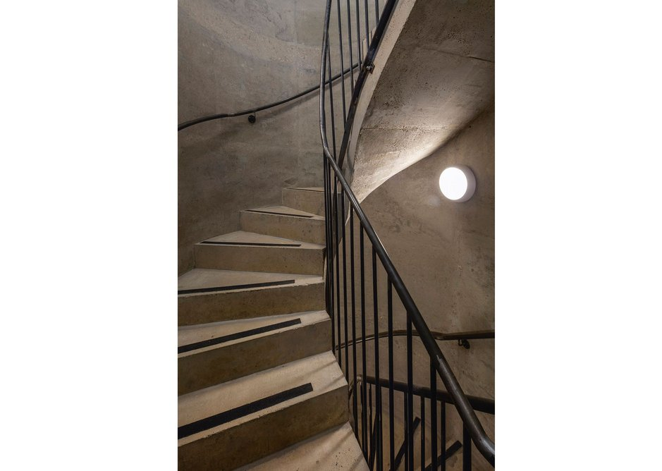 Stairs are tight and industrial in feel, moulded from in situ concrete.