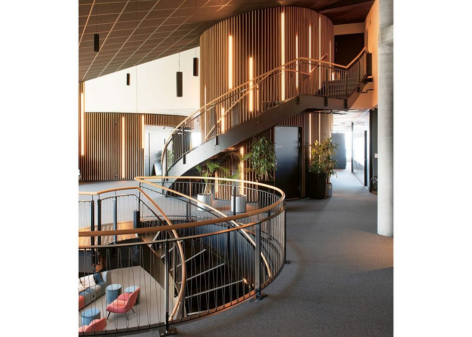 Circular staircases connect office floors and are also crucial to lighting and ventilation.