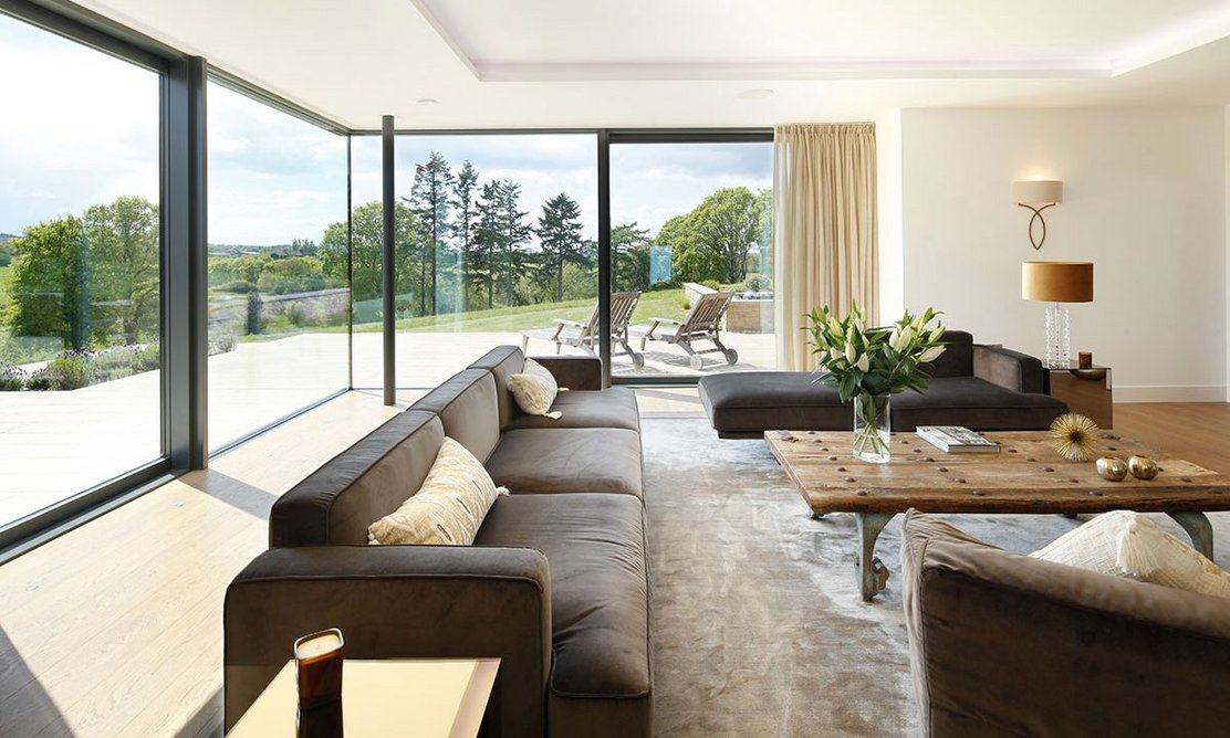 Schüco lift-and-slide doors open up living spaces to the outdoors.