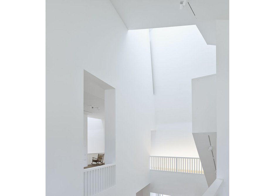 White walls accentuate the lofty volumes within the house