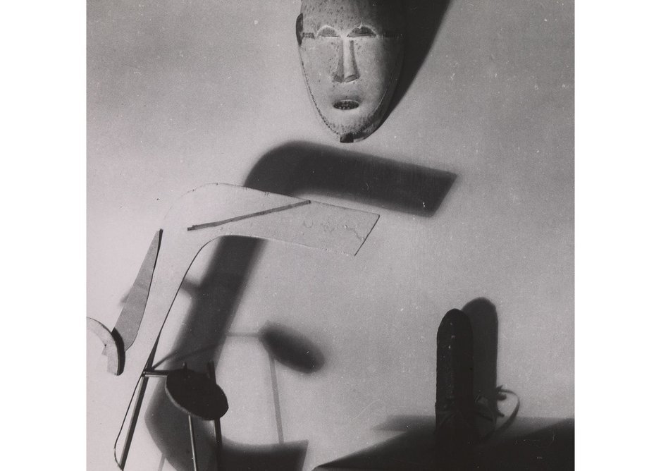 Eileen Gray, Tablescape with Kpan Mask, 1920s. Vintage silver gelatin print 11.2×11.3cm.