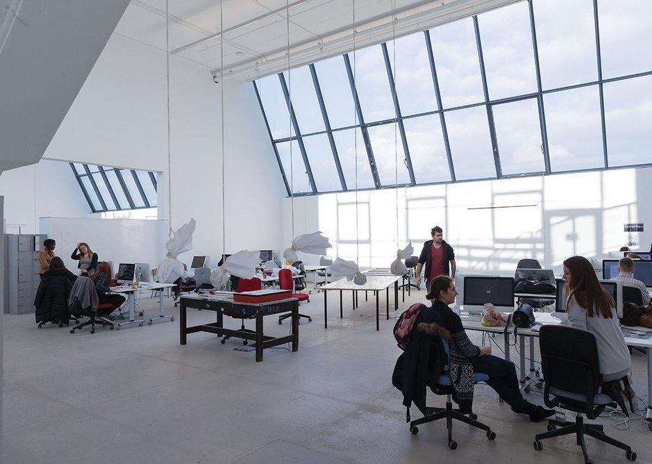 Generous glazing fills the studios with light.