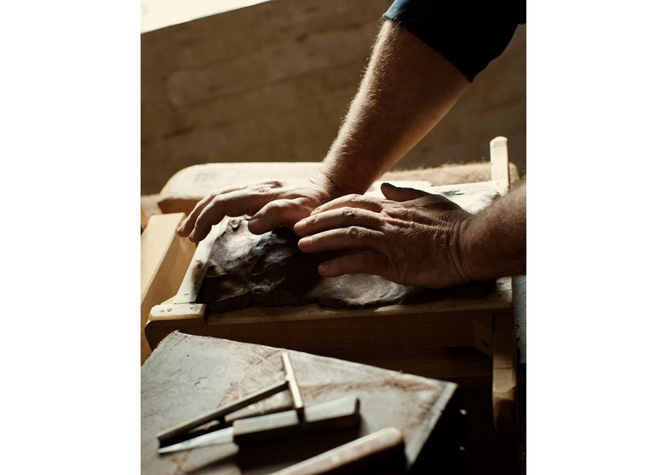 Placing clay in the mould