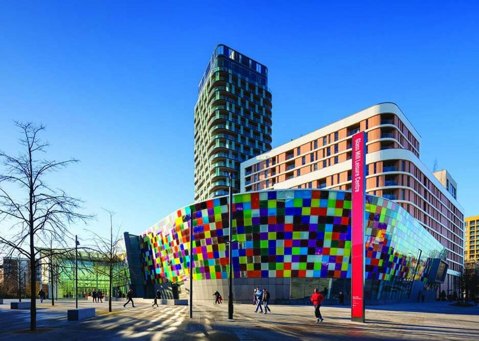 Artist Phil Coy's pixellated interactive glass facade announces the Centre, and faces the street and train station to the south.