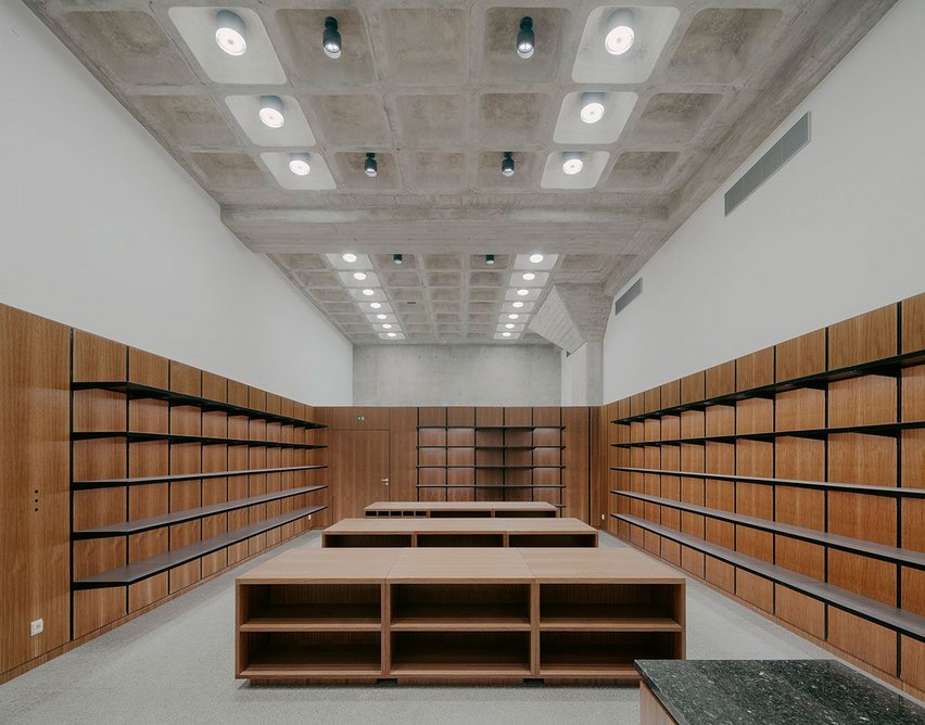 The new shop and garderobe space reveals the beautiful concrete ceiling coffers.