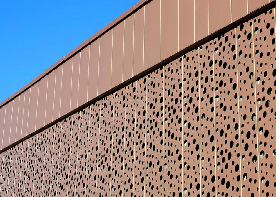 Perforated Pigmento Red Interlocking rainscreen panels, Grenoble.