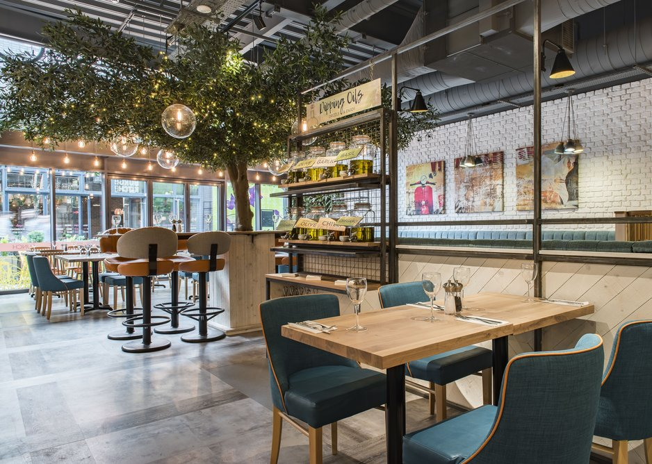 The teal highlights of the Prezzo colour scheme are foregrounded by Interface's natural-look tiles.
