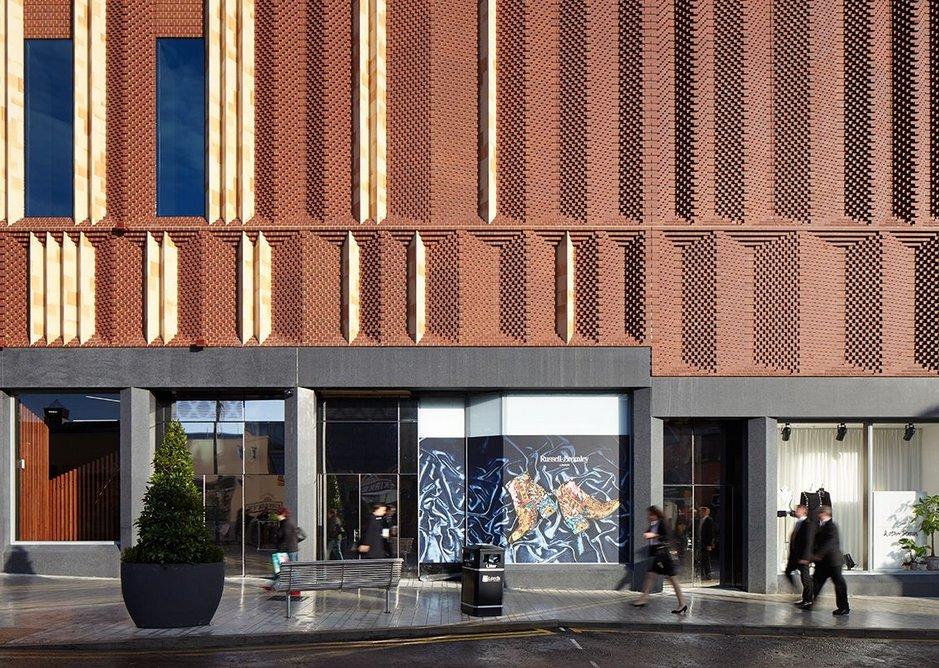 500,000 bricks, erected as panels, went into giving the facade depth.