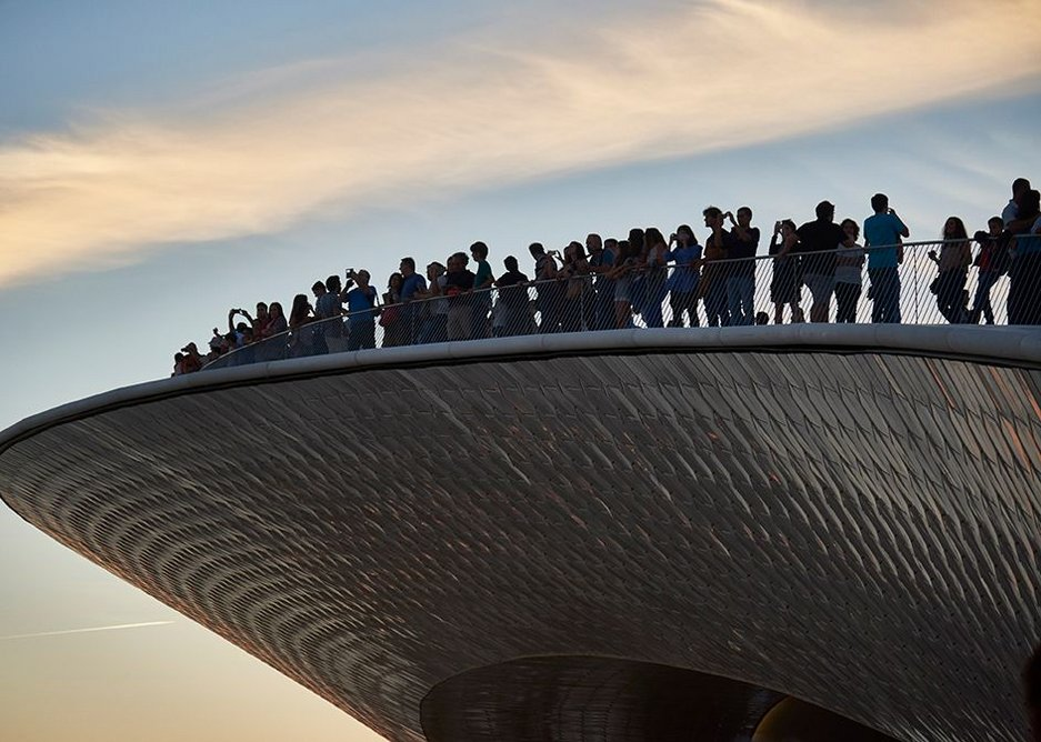 Sunset seeking crowds gather at the prow of MAAT's roofscape.