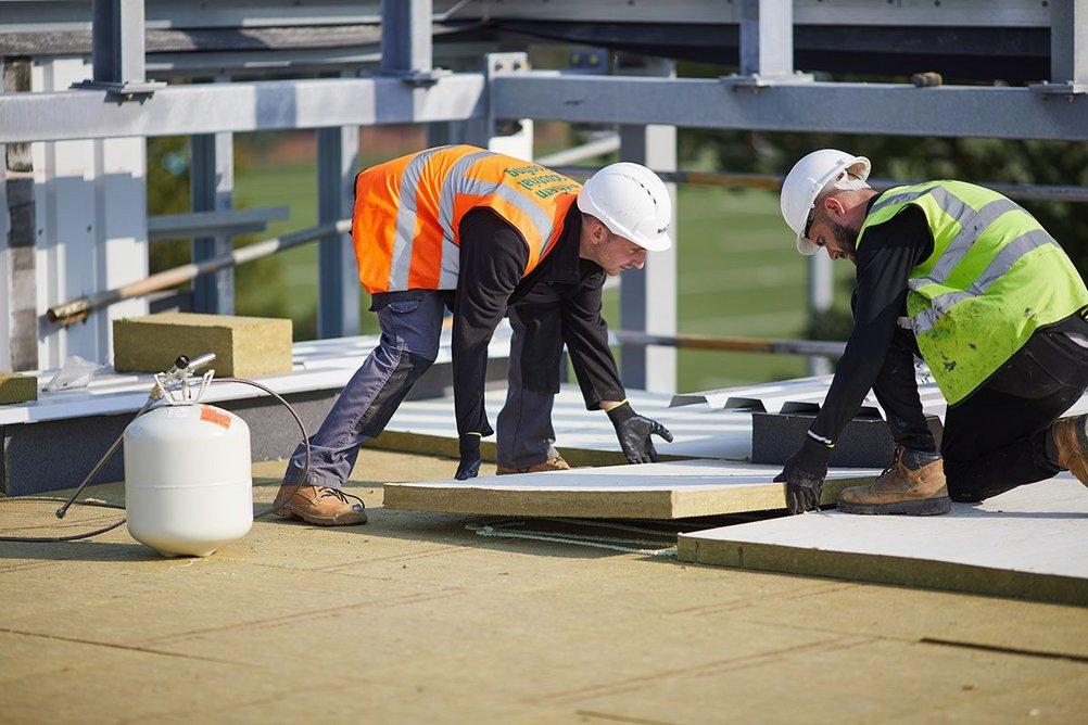 Rockwool Hardrock Multi-Fix (DD) flat roof insulation being installed at Cobham Free School, Surrey.