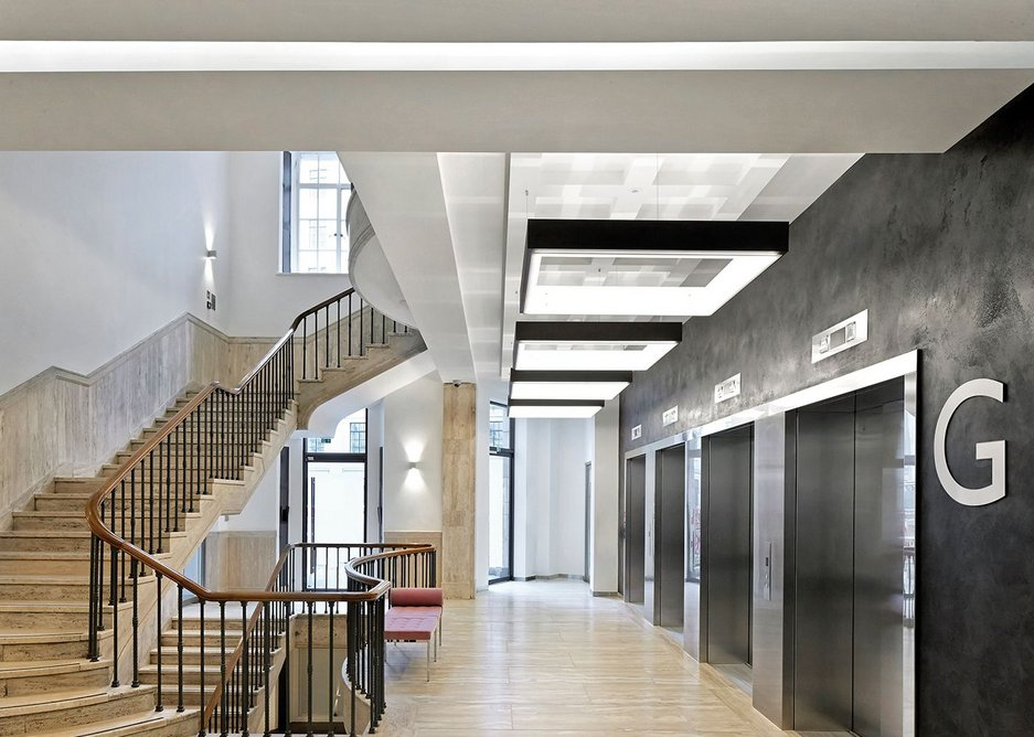 The south east wing's hidden lift lobby is approached using a white plaster wall that draws you in.
