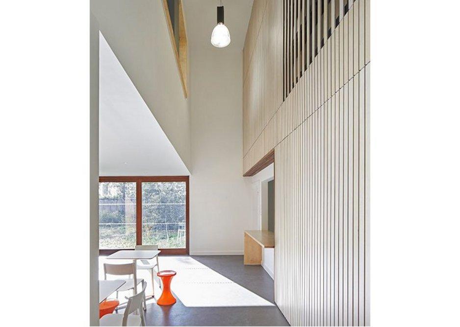 Narrow full-height slot gives internal views through the building