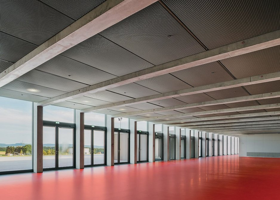 The sizeable entrance lobby eschews Chipperfield's usual materiality for a corporate red polyurethane floor.