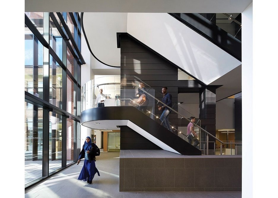 In what was previously outdoor space, the library acquires a new stair clad in dark zinc.