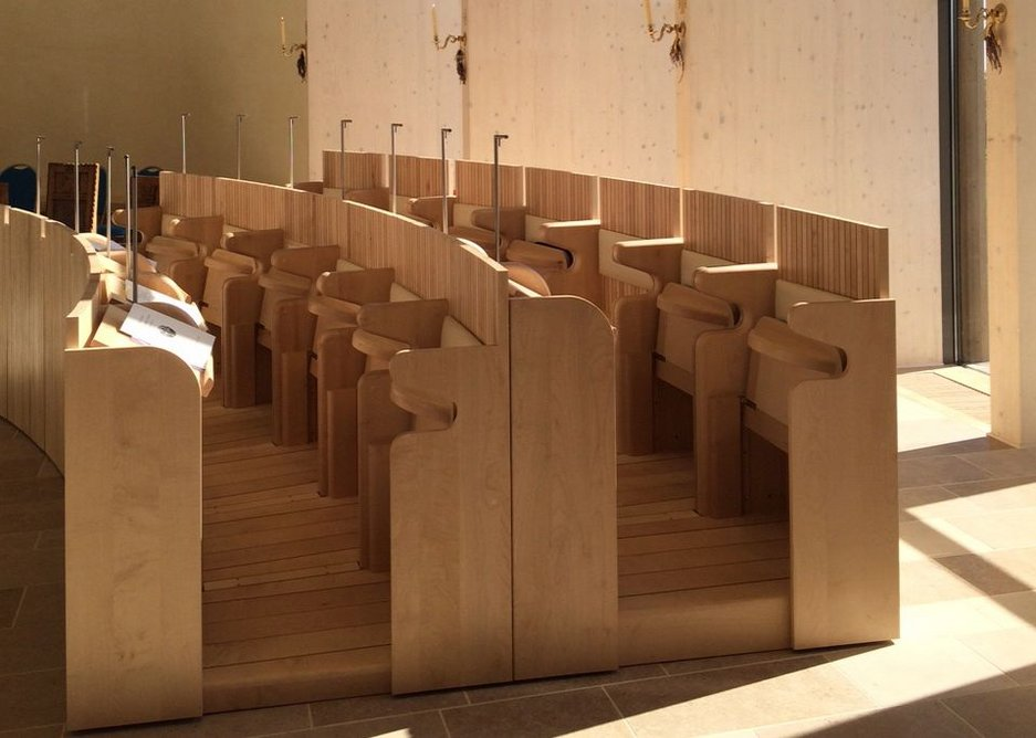 Bespoke sycamore wood choir stalls for the community.