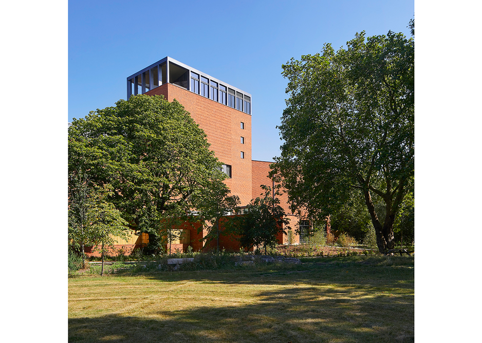 The arms of the library embrace and shelter a new garden by Dan Pearson complete with lake. Credit: Hufton + Crow