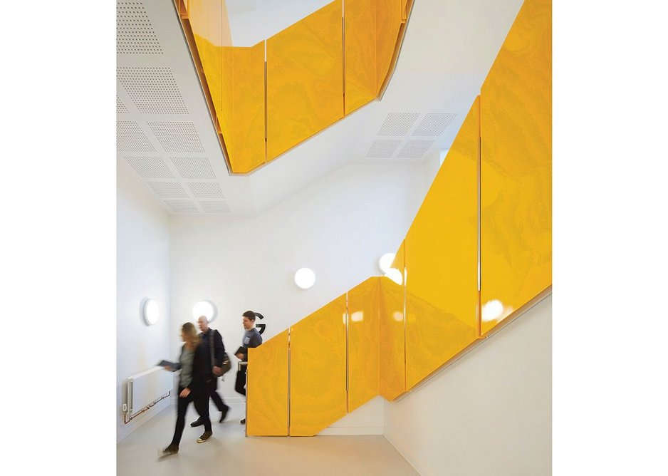 Jazzily colour-coded stairwells help orientate users within the building.