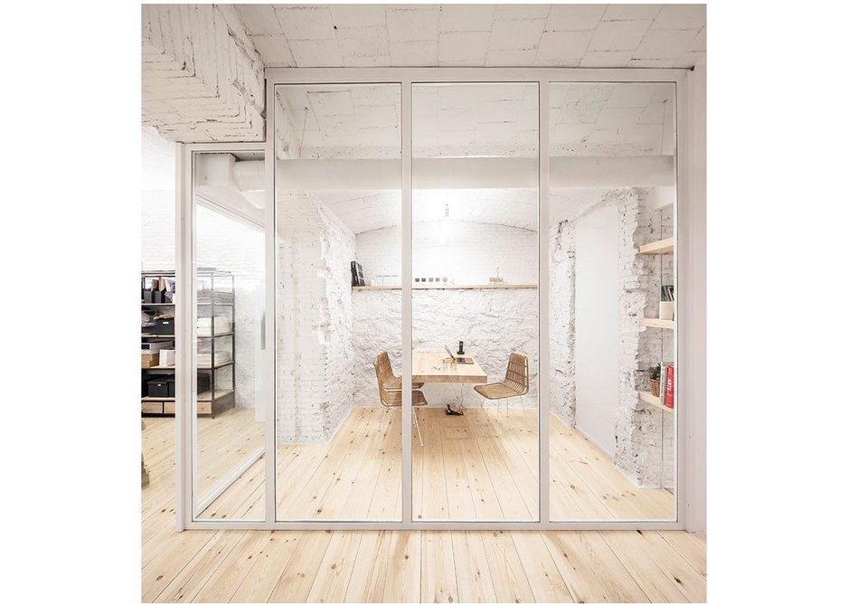 The pine meeting room table projects from the wall- another minimalist intervention.