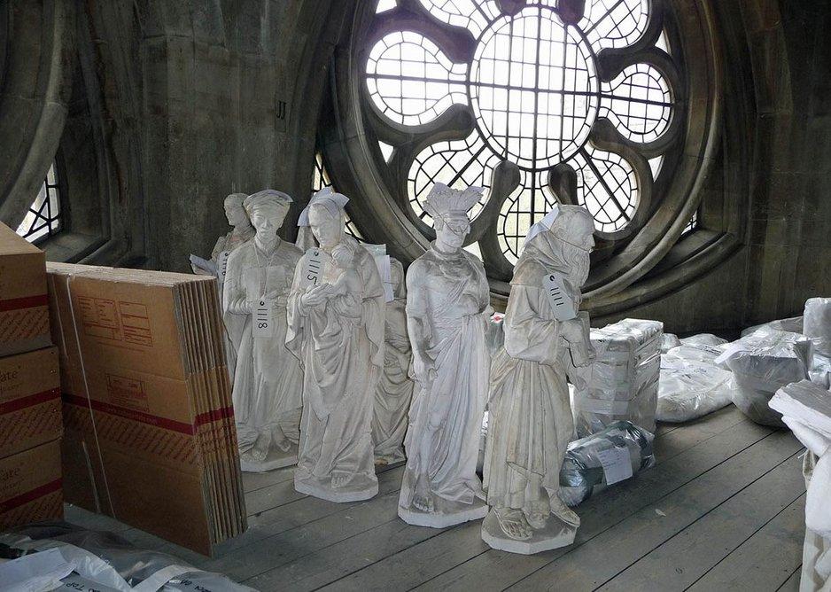 Plaster models of 20th century saints.