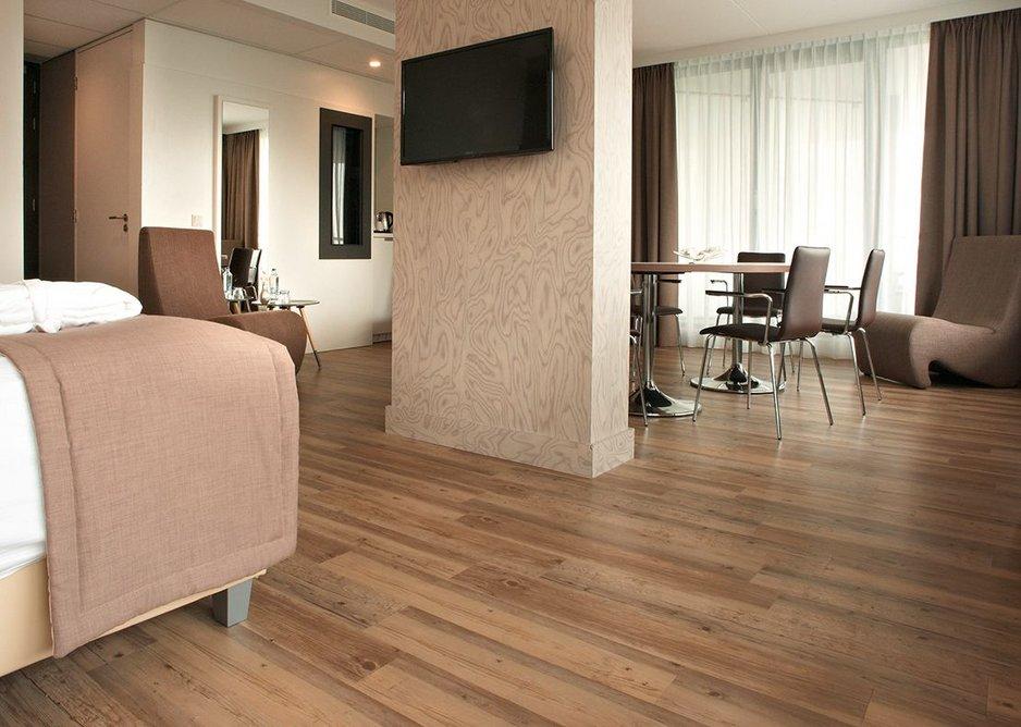 Gerflor flooring installed in a hotel bedroom.