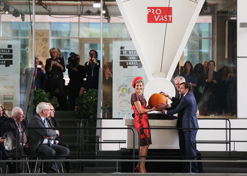 That's Queen Maxima of the Netherlands, receiving a big pumpkin from the developers. Which is nice.