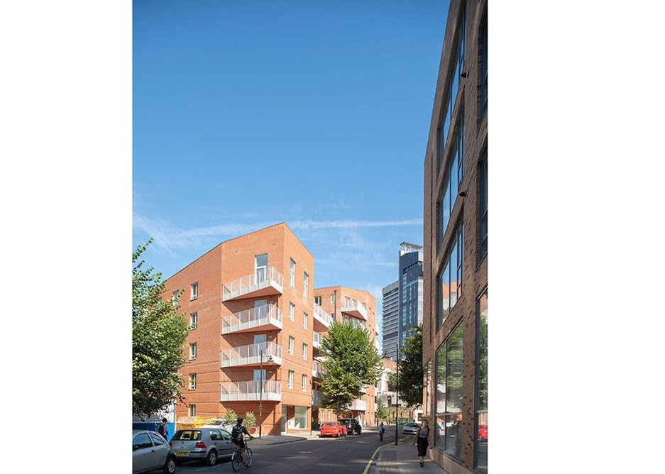 The new building reinforces the street line, its angle countering the orthogonality of the Kipling Estate.