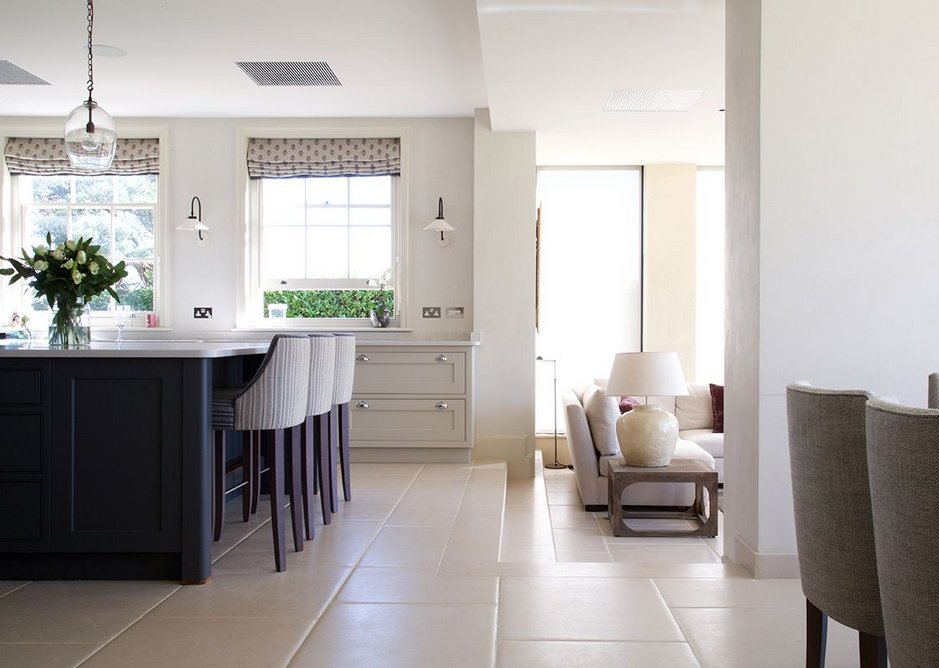 Portland limestone tiles with distressed finish in a contemporary kitchen and living space
