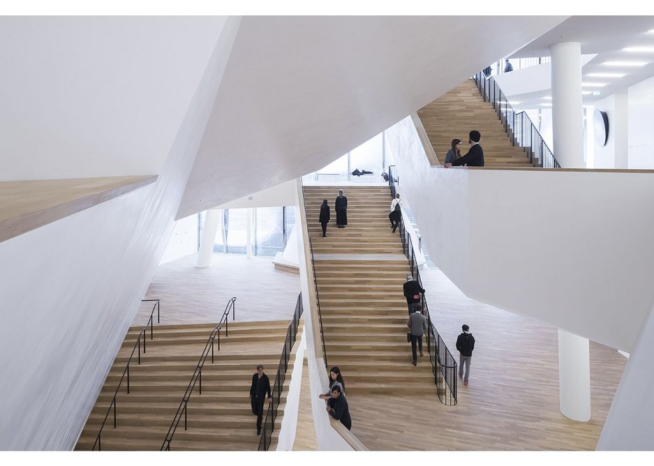 There's an Escher –like quality to the main hall's lobbies, stacked closely on top of one another, and accessed by a multitude of staircases.
