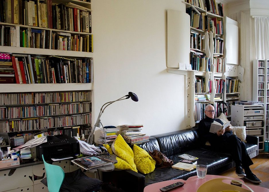 In the living room at the rear of the house, Peter Cook's and Yael Reisner's book collection competes with CDs for space.