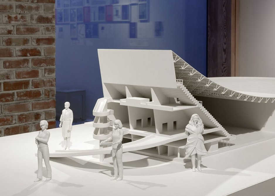3 Ala Younis, Plan for Feminist Greater Baghdad exhibition installation view, 2018. A model of Le Corbusier's gymnasium is accompanied by figures of women from the Plan (fem.) for Greater Baghdad exhibition narrative including Zaha Hadid (right).