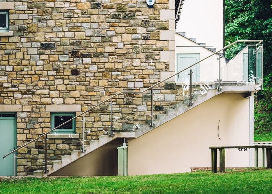 Q-railing's stainless steel Q-line post and clamp system enhances the appearance of the external staircases.