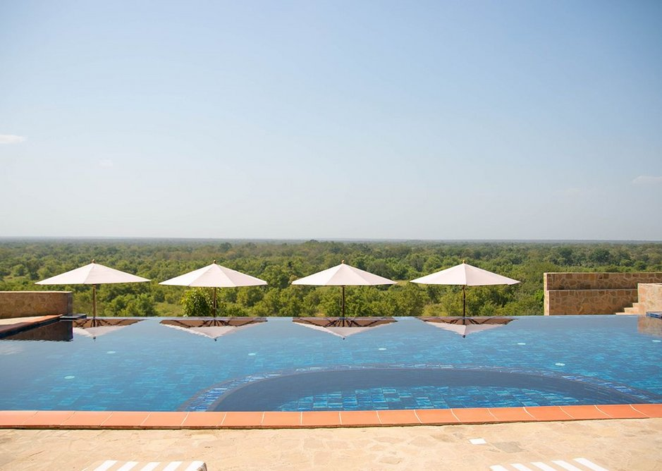 View across the swimming pool over Mole National Park. The tiles are one of the few things sourced from abroad, in this case Japan.